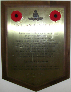 """Memorial – """"IN FLANDERS FIELDS"""" IN MEMORY OF LIEUT. ALEXIS HANNUM HELMER 2ND OTTAWA BATTERY 1ST CANADIAN FIELD ARTILLERY KILLED IN ACTION MAY 9, 1915, AGE 22, AT THE SECOND BATTLE OF YPRES, BELGIUM. HE WAS THE FIRST LISGAR GRADUATE  TO DIE IN WORLD WAR I. HIS DEATH INSPIRED HIS CLOSE FRIEND LIEUT. COLONEL DR. JOHN McCRAE TO COMPOSE THIS IMMORTAL POEM.  ALERE FLAMMAM ERECTED BY THE LISGAR ALUMNI ASSOCIATION IN RECOGNITION OF THE 160 ANNIVERSARY, 2001."""