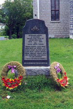 """Memorial – A marble memorial at Tyendinaga Mohawk Territory in RR 1 Deseronto, ON was erected by the Kan-Yen-Cen League. This memorial is dedicated to the memory of the local war dead of the Second World War.  [front/devant]  IN CHERISHED MEMORY OF OUR HEROES WHO GAVE THEIR LIVES IN THE SECOND WORLD WAR 1939 - 1945 FOR JUSTICE - HONOUR - FREEDOM   FRANCIS MARACLE - LLOYD BRANT - HURON BRANT M.M. - RUSSEL LOT - KENNETH BRANT - CLIFFORD BRANT - ELMER BRANT - CLINTON TOPPINGS - ROBERT ARMITAGE - HOWARD GREEN - JOHN CULBERTSON - JOHN MARACLE - WILLARD ZACHARIAH   """"THEIR NAME LIVETH FOR EVERMORE""""   ERECTED BY THE KAN-YEN-CEN LEAGUE http://www.cmp-cpm.forces.gc.ca/dhh-dhp/nic-inm/sm-rm/mdsr-rdr-eng.asp?PID=587    Photo Credit: D.B. Carrington"""