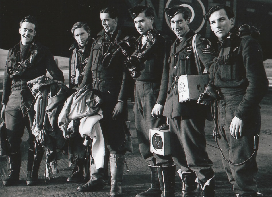 Photo of LEWIS JOHNSTONE BURPEE – F/Sgt Lewis Burpee (3rd from right) and crew. Photo taken at RAF Syerston on 18th January 1943 after an op to Berlin in 106 Squadron Lancaster W4842.