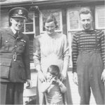 Family Photo – Flying Officer John Gordon McDonald in his parent's sideyard with Sister Margorie and brother Bruce with nephew Ian standing by his mother.