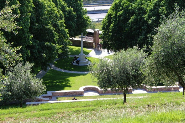 Memorial – View of the Cross of Sacrifice from the tiered rows of Gradara War Cemetery - May 2013