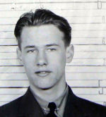 Photo of Kenneth Crawford – This is Ken Crawford in his first week in the RCAF.  This was his intake photo.  It was taken from his paybook in his RCAF file in Ottawa.