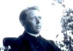 Photo of Thomas Edmund Mooney – Father Thomas Edmund Mooney relaxing and reading a newspaper