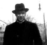 Photo of Thomas Edmund Mooney – Father Thomas E. Mooney looking dapper in his black hat
