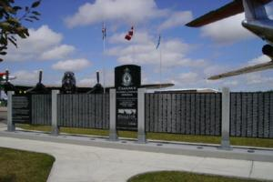 Memorial – Flight Lieutenant Air Bomber Charles Wylie McBride is also commemorated on the Bomber Command Memorial Wall in Nanton, AB … photo courtesy of Marg Liessens