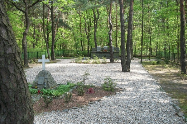 "Memorial – Memorial Garden - The plaque under the cross reads ""Erected by the Prisoners of War of the allied air forces in honoured memory of their comrades who died at Stalag Luft 3 during the war AD 1939-1945 Per Ardua ad Astra"" ... Stalag Luft III, Zagan, Poland … photo courtesy of Marg Liessens"