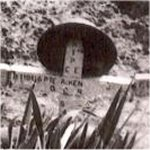 Gravemarker – Photo from 1945 shows the first burial place of Rfn Aiken and 3 other QOR riflemen who were killed at a farm on the outskirts of Rha, Holland on 5/6 April 1945.