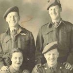 Family photo – John Harrison standing on right with brothers Pat and Del and sister-in-law Betty. Photo taken in England in Spring of 1945.