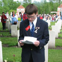 Photo of Adnan Saciragic – Adnan Saciragic, Youth Delegate from Prince Edward Island (PEI), gives a commemorative presentation on the life of John Archibald MacLaren of Goose River, PEI, on May 5, 2005, in front of his grave at Holten Canadian War Cemetery in the Netherlands.