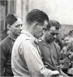 Photo of John Scott – Italian civilians suffered from injuries caused by mines, shells and stray bullets. Many lost their homes and crops. Here gunners Chink Gades and Johnny Scott, 11th Field Regiment, serving corned beef to children in Acireale, December 13th, 1943.