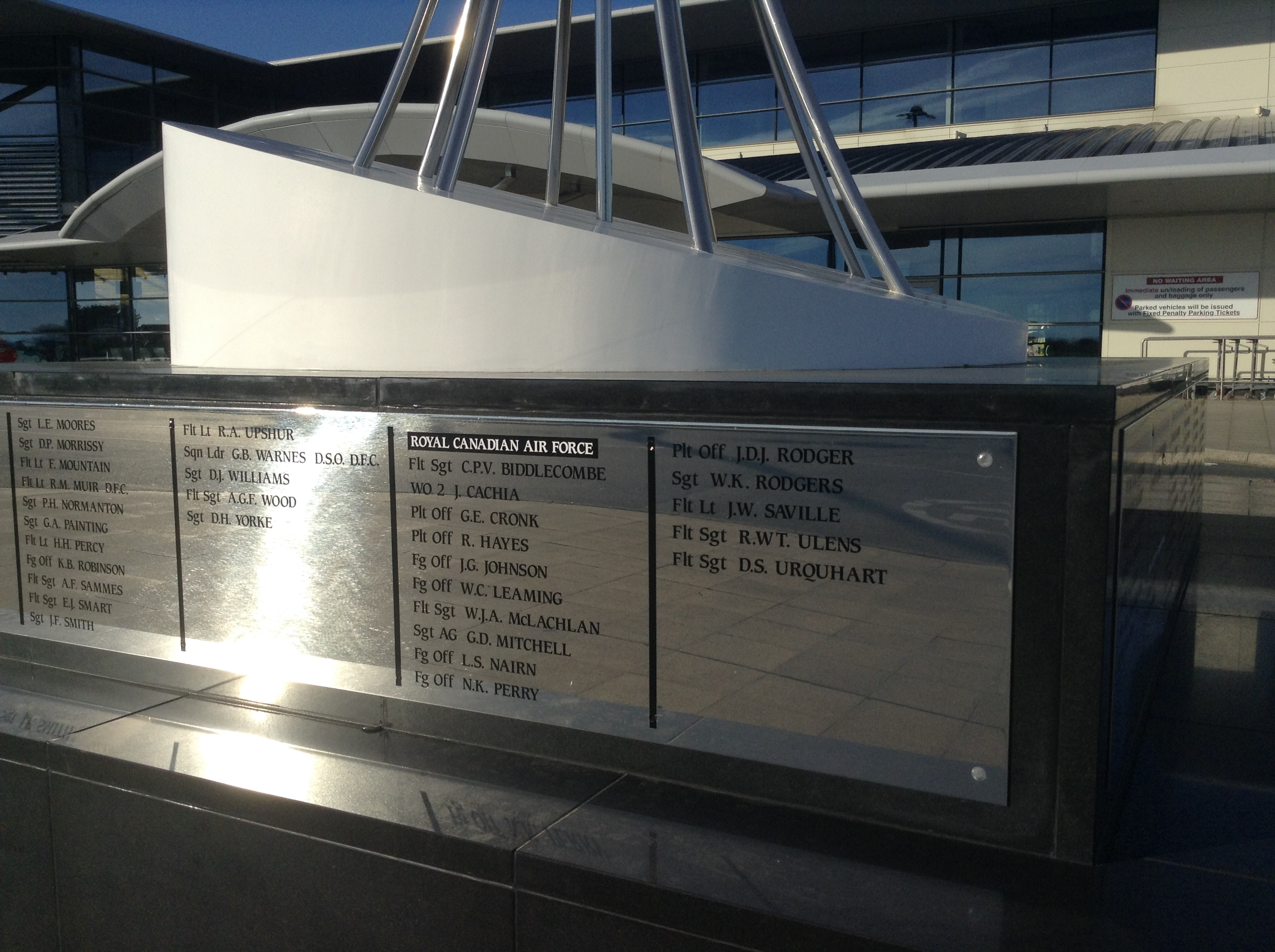 Inscription – The 153 airmen listed on the memorial came from the United States, Canada, Australia, New Zealand, Czechoslovakia and the United Kingdom. Some were shot down while carrying out missions over the German occupied Channel Islands, while others were returning from missions elsewhere in Europe.  Allied Airmen Memorial is located at Guernsey Airport, La Villiaze, Forest, Guernsey.  Photo courtesy of John S. Brehaut.
