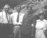 Family photo – Alcide, Sam, Leo, and Rose Deschamps on a trip to Montreal, Quebec on Leo's last leave in Canada.  Sam served with the U.S. Navy.