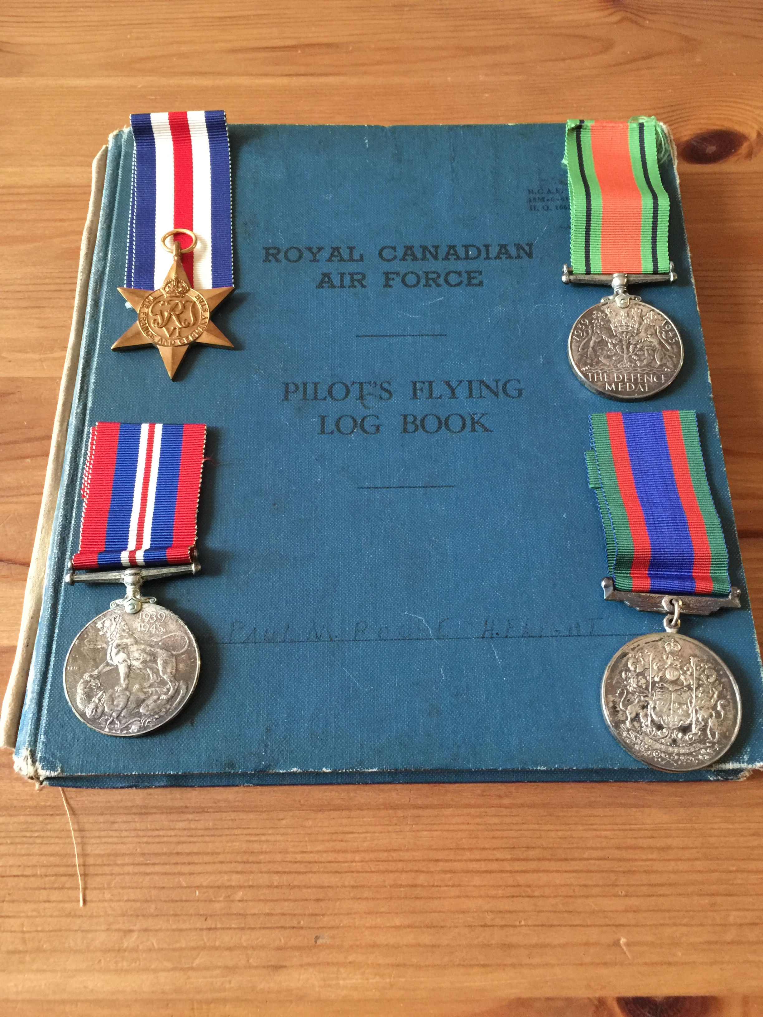 Paul's service medals and RCAF flight log