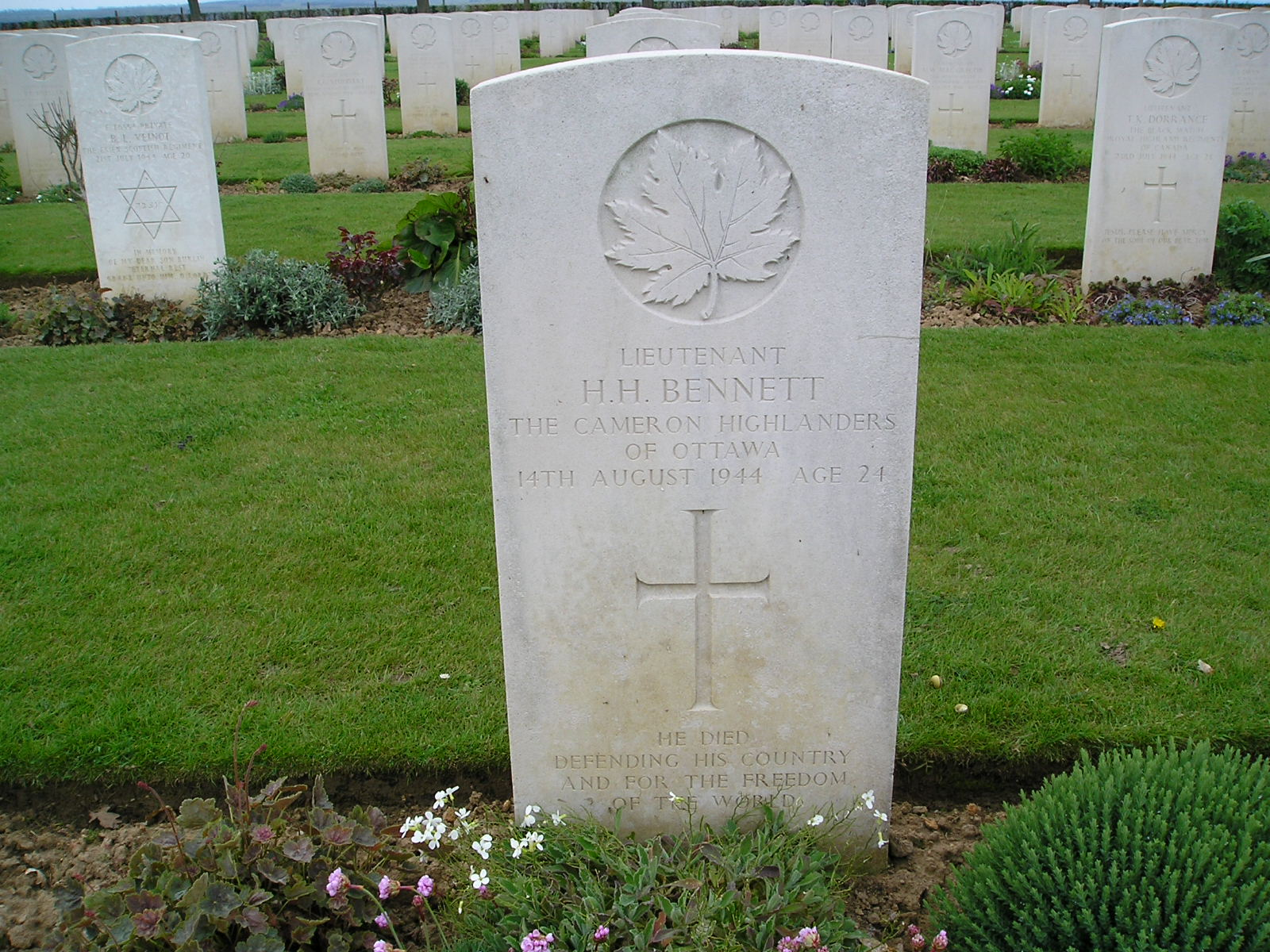 Grave Marker – Henry Harrison Bennett, nephew of Prime Minister R.B. Bennett,  is buried in the Bretteville-sur-Laize Canadian War Cemetery which is found on the main road between Caen and Falaise.  His brother Edwin Roland Bennett is buried in the same cemetery.