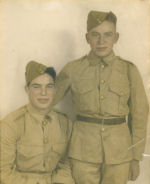 Photo of George Price – George Price (standing) with Brother Leonard 'Bud' Price.