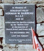Commemorative Plaque – Memorial plaque dedicated and unveiled in The Rose Garden in Ermin Street, Stratton St. Margaret, Swindon in memory of Norman Barbeau whose Spitfire crashed almost opposite in December 1941.