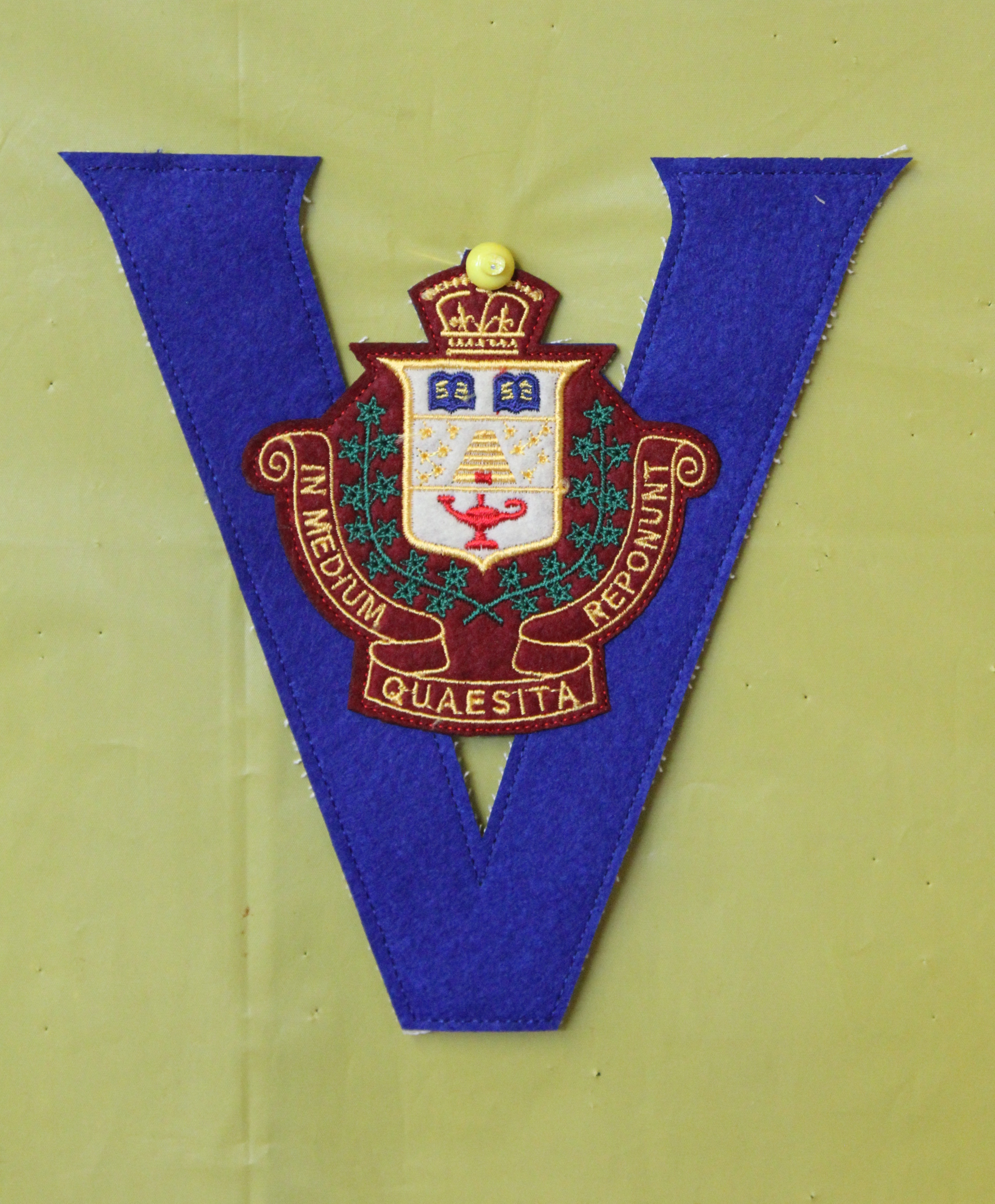 Badge – In memory of the students from the Vaughan Road Collegiate Institute  (Toronto) who went away to war and did not come home. Submitted for the project, Operation Picture Me