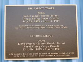 Memorial – This plaque is displayed on the outside of Talbot Tower, the control tower on the airfield at Canadian Forces Base Borden, Ontario.  (Image taken by Gregory J. Barker of Barrie, Ontario, in 2018.)