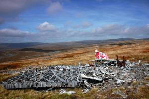 Crash site – On 9th November 2014, a Canadian Bomber Crew Memorial, was dedicated on Roade Memorial Green, Tal-y-Bont, Brecon Beacons, Wales to the six RCAF men who lost their lives when their Wellingtonbomber exploded over Roade 70 years previously. On July 6, 1942 a Wellington Bomber took off from the Operational Training Unit at Wellesbourne Mountford, near Stratford-upon-Avon, for a cross-country training exercise. In dense cloud the pilot decided to descend from his advised level of 10,000 feet to try and fix his position. He hit the summit of Waun Rydd. The crew were only 30 metres or so from clearing the wide plateau at the top of the mountain.