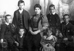 Cahill family photo – Cahill family photo, taken in 1897, John is the boy in the front, Martin is located at the extreme left.