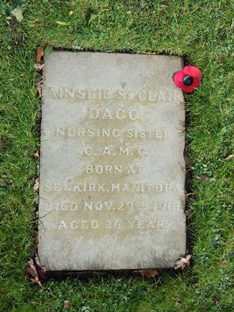 Grave Marker – Nursing Sister Ainslie St. Clair Dagg's grave at the War Memorial Garden at Cliveden, England. The photograph was taken in 2014 by Susan Dutton, Archivist at the Bishop Strachan School. Ainslie Dagg attended the school in 1910-1911.