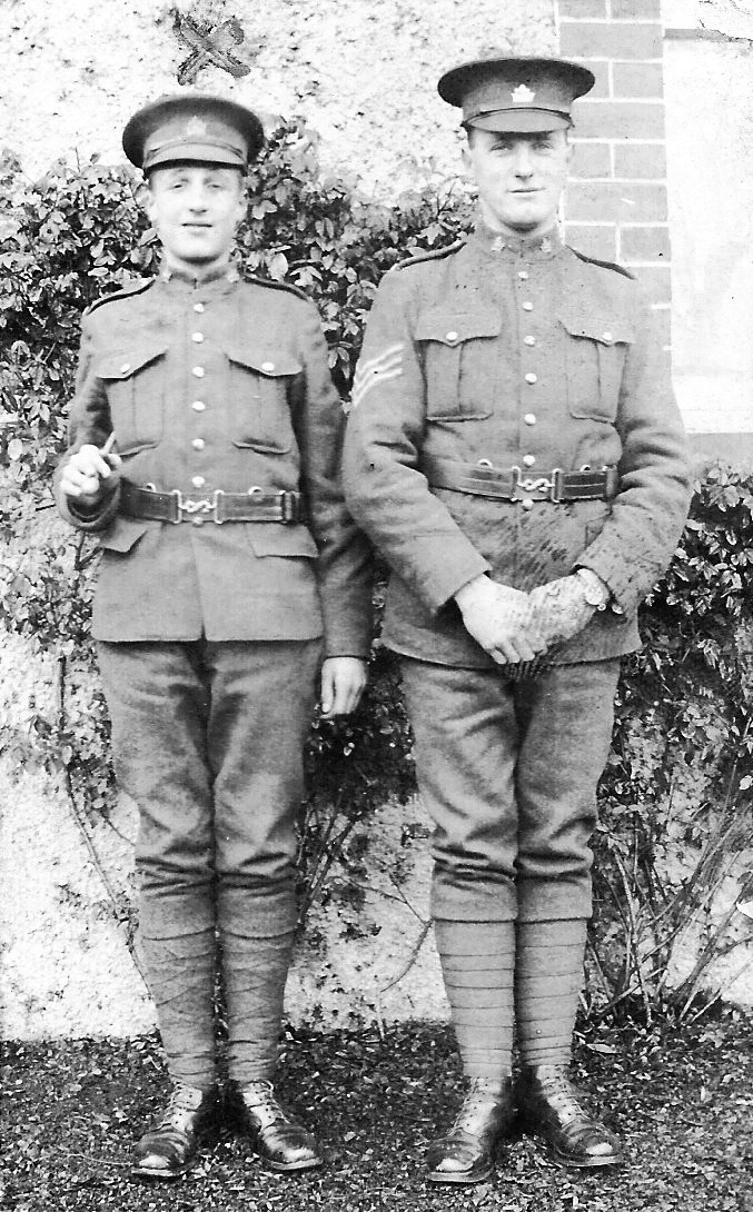 "Group Photo – John Shaw (603137, died 3 weeks after Robert) on the left; Robert Howe (602253) on the right. Robert's military record shows he was a Sgt. In handwriting, on the reverse of the photo: ""Loyal chums to the end Pte Shaw Sgt Howe"""