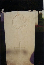 Grave Marker – A photograph of the headstone at the Ramparts Lille Gate Cemetery, just inside the Lille Gate at Ieper (Ypres), Belgium. May he rest in peace. (J. Stephens)