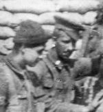 Photo of Edward Lock – A photo of Pte. Eddie Lock and Sgt. Slater, 3rd (Toronto) Battalion taken in the trenches at Plogsteert Woods, near Ypres, September, 1915.