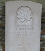 Grave Marker – Canadian pride - A poppy cross and a Canadian flag were placed at the grave site of James (Jimmy) Morrison to show a family's love and respect for a fallen soldier