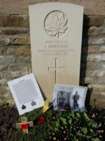Grave Marker – Here is a picture of Jimmy that was taken before the war, a photo of Jimmy and his father, and a poppy cross that was left at his gravesite during my last visit.