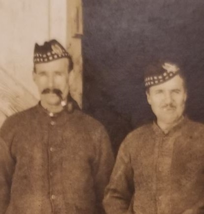 Photo of DONALD MCLEAN – Picture postcard sent to his niece, Mary McLean Liddell, by Donald McLean. He is the gentleman in the middle. Taken in front of a stable where he and his battalion were billeted (4 to a stall, according to what he wrote on the back of the postcard).