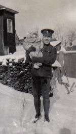 Group photo – John Gardner holding his niece, probably Spring, 1916.