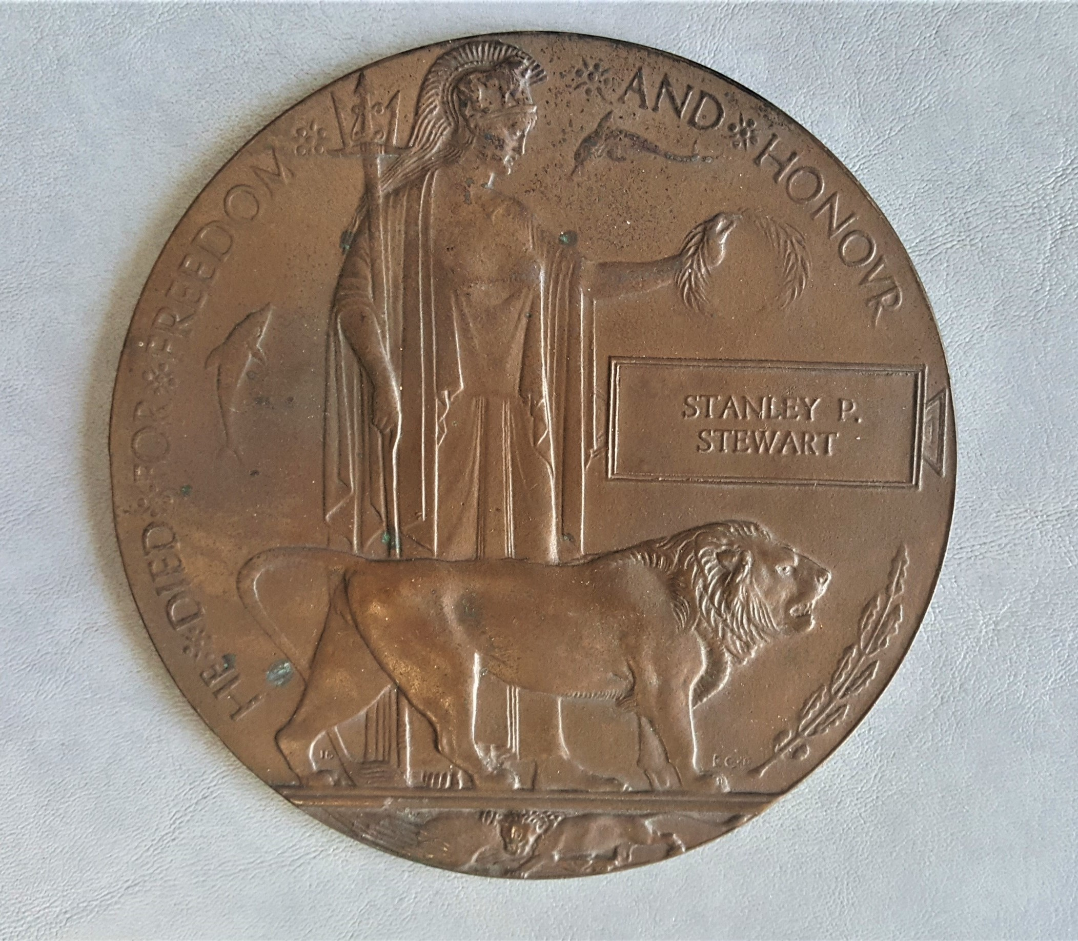 """Memorial Plaque – Captain Stanley Peter Stewart's """"dead man's penny"""" was presented to his parents Peter and Martha Stewart.  It was passed to Stanley's brother Neil Stewart then to Neil's son Doug Stewart then to Doug's daughter Linda (Stewart) Jones.  This memorial plaque was the catalyst for Linda to find out more information on her great uncle and his sacrifice at Vimy Ridge."""
