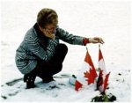 Photo of Carol Isfeld, Mark's mother – This picture of Carol Isfeld, Mark's mother taken in december 1994 in Chilliwack, at Little Mountain Royal Canadian Legion Cemetery before the permanent headstone was placed, speaks for itself. Mrs. Carol Isfeld was the National Silver (Memorial) Cross Mother for 2000.  The National  Silver Cross Mother is chosen annually by The Royal Canadian Legion to  represent the mothers of Canada at the National Remembrance Day Ceremony in Ottawa on 11 November.  As the Silver Cross Mother she will lay a wreath at the base of the National War Memorial on behalf of all mothers who lost children in the military service of the nation. Photo by Brian Isfeld
