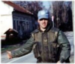 """Mark Isfeld in Croatia – Mark Isfeld in Croatia, Oct 92 - Apr 93.  OP HARMONY, First tour.  Mark """"Hitchhiking"""" in the Former Yugoslavia while on his first UN tour.  Taken by one of his section from the APC with Mark's camera."""