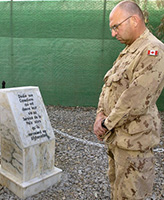 Memorial – Chief Warrant Officer Steve Bartlett, Task Force Afghanistan's Regimental  Sergeant Major takes time to reflect on the fallen. A consecration ceremony was held of the Memorial dedicated to those Canadians who gave their lives in the service of peace while serving in Afghanistan. This Memorial was  originally consecrated in November 2003 at Camp Julien, Kabul. The closure of Camp Julien in November 2005 necessitated the move of the Memorial to its present location at Kandahar Airfield, Afghanistan.  Photo taken on February 21, 2006 by: Master Corporal Ken Fenner, Task Force Afghanistan Photographer