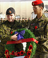 Memorial Service – On 11 November 2004 at Kabul, Afghanistan, a wreath in honour of Canadian Soldiers killed in Afghanistan is laid on the Camp Julien Memorial by Corporal April Pettipas (Left) and Cpl Karin Simmons during the Remembrance Day parade at Camp Julien in Kabul, Afghanistan. Cpl Pettipas is the cousin of Private Nathan L. Smith who was killed by friendly fire on 17 April 2002 in 