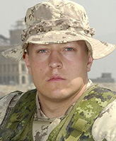 Photo of Braun Scott Woodfield – Private Braun Scott Woodfield of Victoria, B.C was killed and four other Canadian soldiers were injured when their Light Armoured Vehicle (LAV III) rolled over approximately 45 km northeast of Kandahar.  Photo credit: National Defence (photo taken on August 26, 2005, in Kabul, Afghanistan)