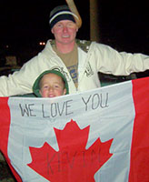 Photo of Kevin Megeney – Kevin and his nephew Bradley with the flag Bradley made Kevin the day he left.  December 6/06