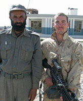 Group Photo – Pte. Joel Vincent Wiebe posing with an Afghan Police Chief in the Panjwaii District Afghanistan, Spring 2007.