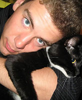 Photo of Joel Vincent Wiebe – Joel with his rescue cat Hobbes who was born with only 3 legs and a very crooked tail. His love of animals was present his entire life.