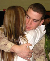 Photo of Joel Vincent Wiebe – Pte. Joel Vincent Wiebe and his Mom hugging good-bye during the very early morning hours of February 20, 2007 as he began his deployment to Afghanistan from Edmonton Garrison.