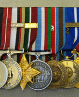 Medals – These are Sgt. John Wayne Faught's service medals. Photo provided by Phil Miller who court mounted them.