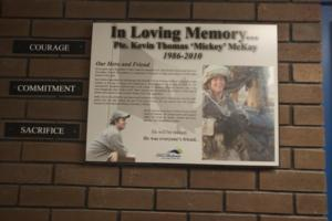 Memorial Plaque – Memorial plaque in Eastview Secondary School, Barrie, Ontario, where Private McKay formerly attended high school.  (Image taken by Gregory J. Barker of Barrie, Ontario, in 2018.)