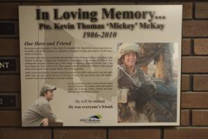 Memorial – A closer view of the memorial plaque on display in a hallway of Eastview Secondary School, Barrie, Ontario.  (Image taken by Gregory J. Barker of Barrie, Ontario, in 2018.)