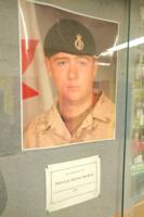 Memorial – Picture displayed in a hallway of Eastview Secondary School, Barrie, Ontario, in memory of Private Kevin McKay, Eastview graduating class of 2004.  (Image taken by Gregory J. Barker of Barrie, Ontario, in 2018.)