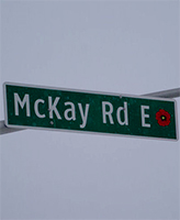 McKay Road – Street sign on McKay Road (formerly the 10th Line), Barrie, Ontario.  This road was named in memory of Private K. T. McKay.  A remembrance poppy is depicted on the right side of the sign.  (Image taken by Gregory J. Barker of Barrie, Ontario, in 2014.)