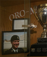 """Kevin McKay Cup – The Kevin McKay Cup, on display in the Oro-Medonte Community Arena, Guthrie, near Barrie, Ontario.  It is awarded annually to the winning team in the Kevin McKay Memorial Tyke Tournament.  This trophy was named in memory of Private Kevin T. (""""Mickey"""") McKay, who as a youngster played hockey in the Oro Minor Hockey Association.  (Image taken by Gregory J. Barker of Barrie, Ontario, in 2013.)"""