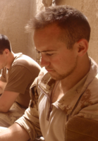 """Photo of BRIAN NEIL CALVIN PINKSEN – Taken in 41B section room in Nakhonay, Afghanistan July 2010. During our """"down time"""" we often just sat around and chatted. With no amenities, electricity, or running water we relied on each other for entertainment."""