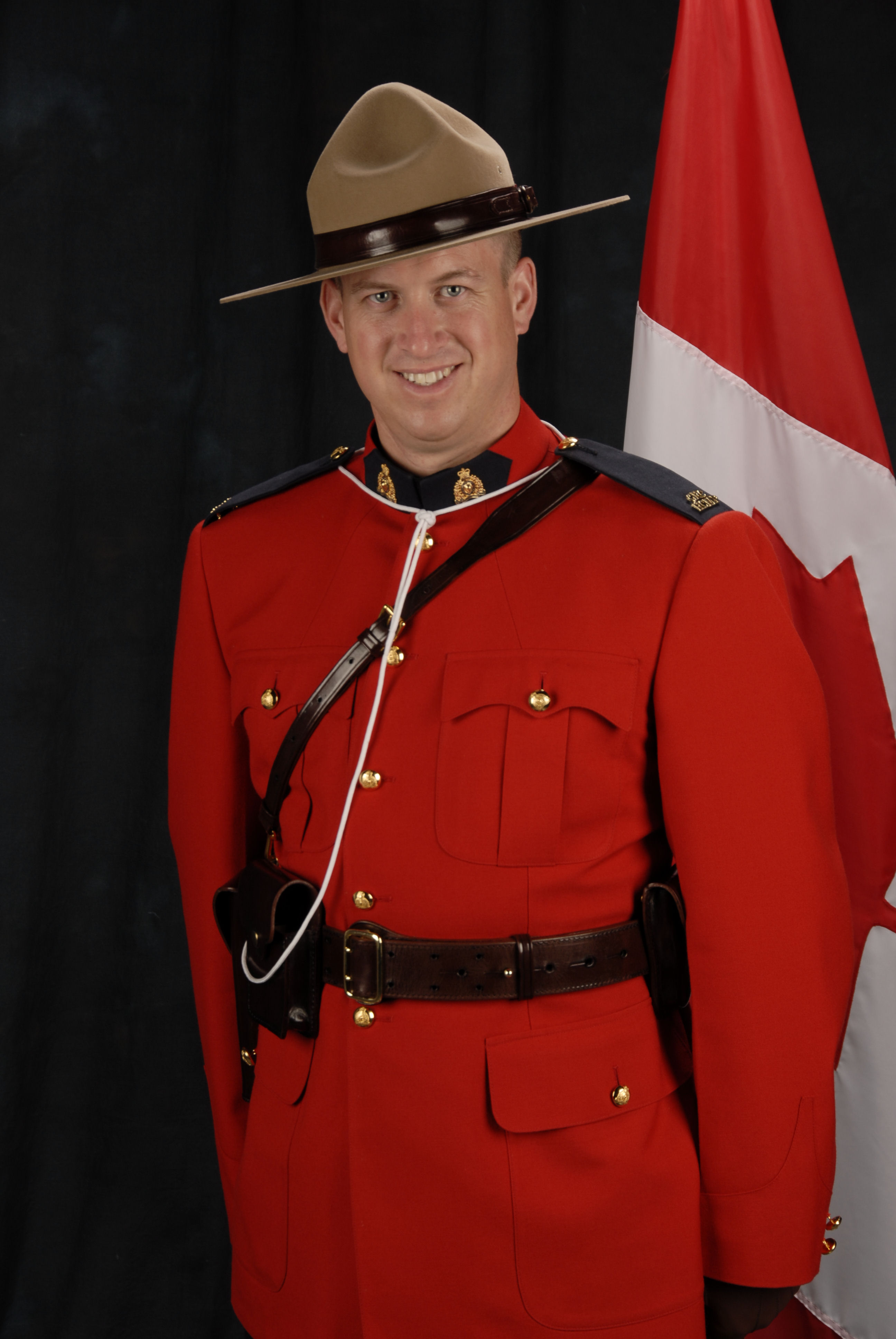 Photo of DEREK WILLIAM HENRY PINEO – Cst. PINEO's happier official RCMP photograph. This is how we, his friends and troop mates, remember him. He always had a way to make everyone around him smile and laugh.